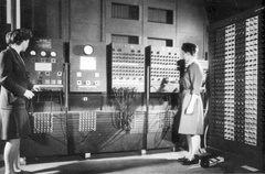 Programmers Betty Jean Jennings (left) and Fran Bilas (right) operate the ENIAC's main control panel at the Moore School of Electrical Engineering. (U.S. Army photo from the archives of the ARL Technical Library)